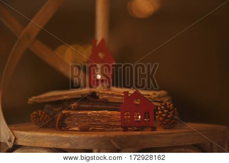 Old books and decor on wooden chair, closeup