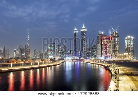 Panoramic view over the Dubai Water Canal and Downtown Skyline illuminated at night. United Arab Emirates Middle East