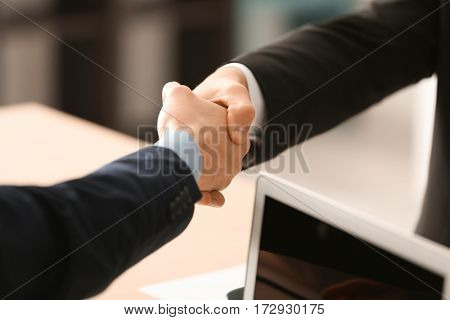 Closeup of business handshake in office