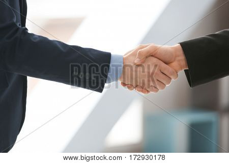 Closeup of business handshake indoors
