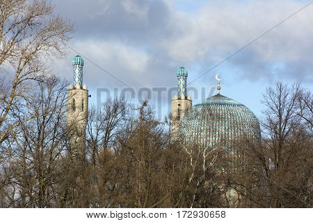 Cathedral mosque of St. Petersburg gambit dome turrets minarets trees blue sky clouds religion Islam architecture culture