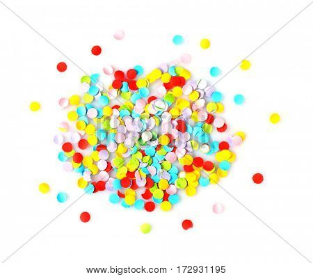 Bright confetti in shape of circle on white background. Close up