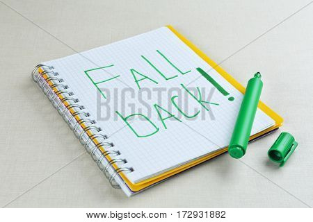 Phrase FALL BACK in notebook