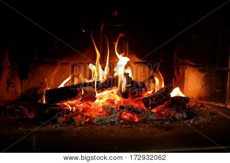 Cosy fire place at home. Winter warm