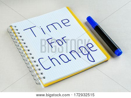 Phrase TIME FOR CHANGE in notebook