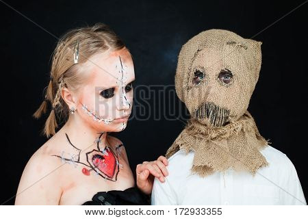 Young Girl and Boy with Halloween Makeup