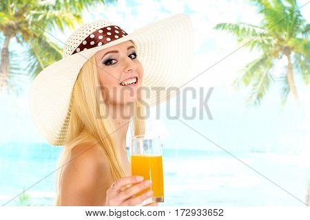 Charming blonde with a bright appearance is resting at a resort