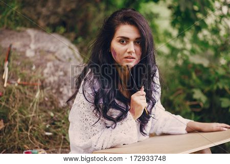 artist girl walks in the park. draws a picture. and resting