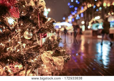 Decorated Christmas tree on street of city