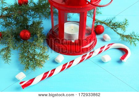 Christmas decoration with candy cane on blue wooden background