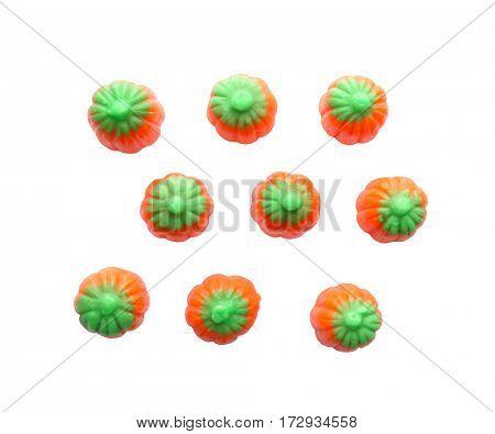 Colorful Halloween candies on white background