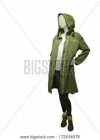 Full-length female mannequin dressed in green raincoat with hood isolated on white background.