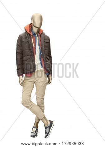 Full-length male mannequin dressed in casual clothes (jacket and trousers) isolated o n white background. No brand names or copyright objects.