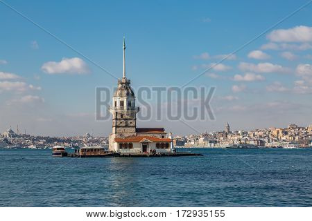 Maiden tower with karakoy background  with partly cloudy sky