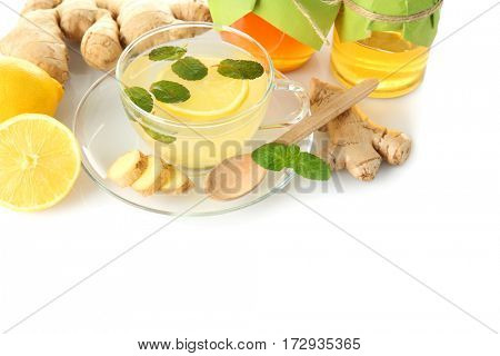 Natural medicine concept. Ginger honey tea with lemon and mint on white background