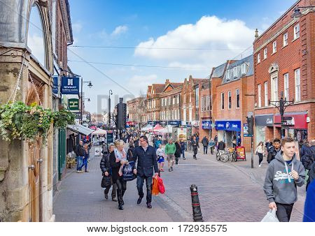 Newbury, UK. 18th February 2017. People are walking along Northbrook Street, one of the pedestrianized town centre streets on a Saturday afternoon.