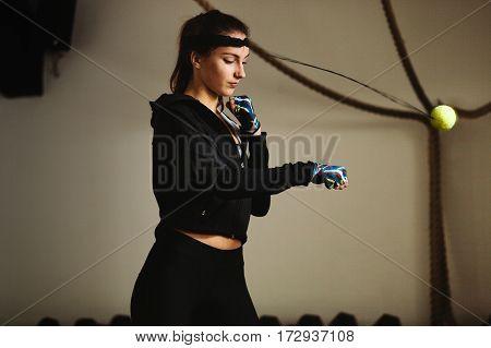 boxing girl train punching. Beautiful model boxing in gym.