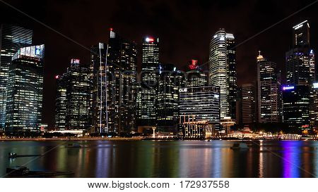 MARINA BAY SINGAPORE - JAN 19 2017: Landscape of the bay front in the scene of commercial buildings in Singapore.