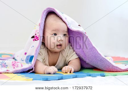 Portrait Of A Little Adorable Newborn Infant Baby Girl With Blanket And Saliva Lying On The Tummy On