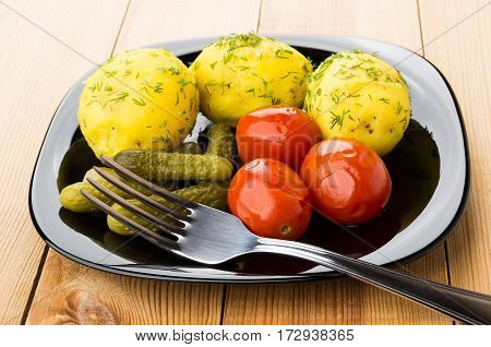 Baked Potatoes With Dill, Pickled Gherkins And Tomatoes, Fork