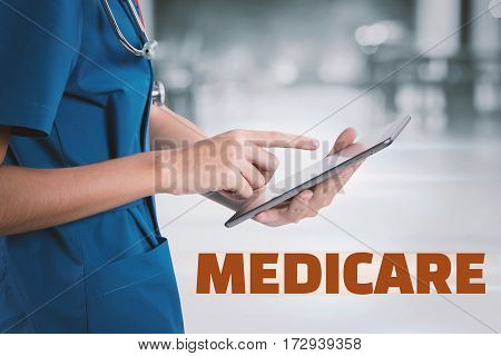 Female Doctor Using Tablet With Medical Malpractice Text.