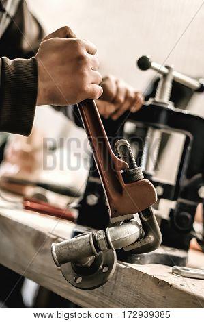 Carpenter Using Plier For His Job In Carpentry Workshop