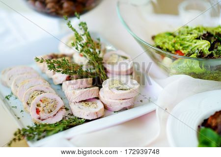 Delicious Chicken Or Turkey Rolls With Herbs Served On A Party Or Wedding Reception