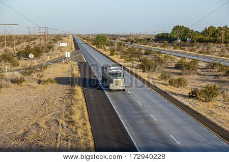 Truck On  Interstate 8 In The Desert Area Of Arizona In Morning Light