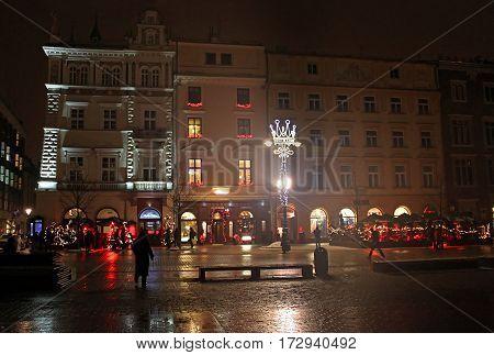 KRAKOW, POLAND - DECEMBER 29, 2010: Main Market Square (Rynek Glowny) at night