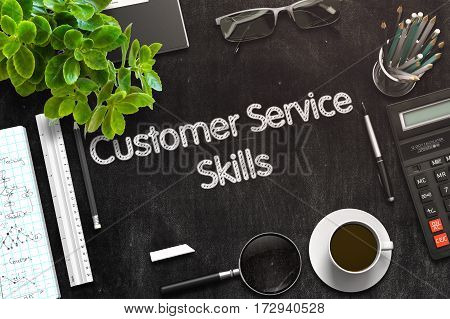 Customer Service Skills - Black Chalkboard with Hand Drawn Text and Stationery. Top View. 3d Rendering. Toned Illustration.