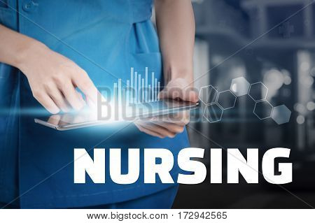 Nurse Touch Her Tablet With Nursing Text Display.