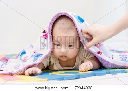 Portrait Of A Little Adorable Infant Baby Girl With Blanket And Saliva Lying On The Tummy On Colorfu