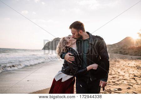 A Loving Couple Kissing On The Sandy Beach Near The Sea.