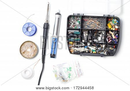 Electronics parts and components and tools for soldering, solder iron on a white background