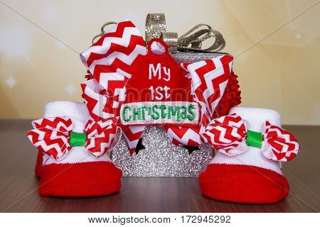 Booties and headband celebrating baby's first Christmas
