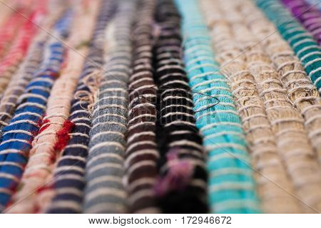 Colorful carpet texture. Background of andalusian carpet. Jarapa. Handmade carpet. Close up of beautiful hand made carpet. Abstract background and texture for designers.