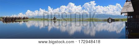 Reflection like mirror on Inle Lake in Myanmar