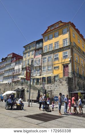 PORTO, PORTUGAL - AUGUST 5, 2015: People at the streets of the Ribeira one of the more typical places of the city of Porto Portugal.