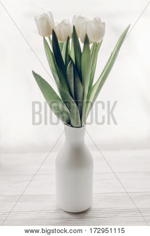 Stylish White Tulips In Minimalistic Fashionable Vase On Wooden Rustic Windowsill In Soft Morning Li