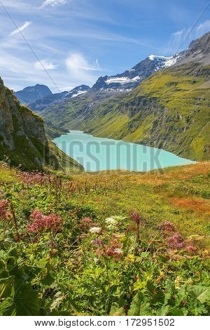 picturesque rural landscape with glacial lake in the Swiss Alps, Switzerland