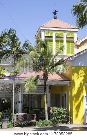 The yellow color restaurant surounded by palms on Paradise Island (The Bahamas).