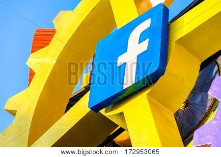Cento Italy 19 feb 2017: Facebook icon on a big gear. Facebook is a famous worldwide web social network