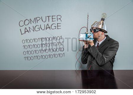 Computer language text with vintage businessman kissing machine