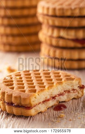 Several Biscuits With Red Homemade Marmalade On Light Wooden Board