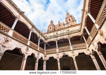 Famous Patio De La Casa De Las Conchas With La Clerecia Church In Salamanca, Castilla Y Leon, Spain