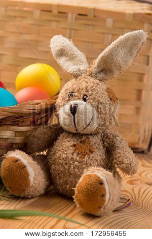 Basket With Colored Eggs And The Easter Bunny For Easter