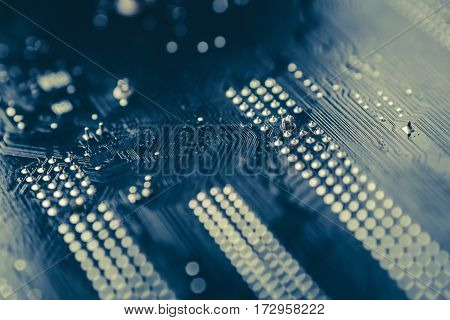 Tech science background. Circuit board. Electronic computer hardware technology. Toned image, macro photo