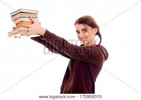happy stylish student girl with pigtails in brown sports clothes and books in her hands smiling isolated on white