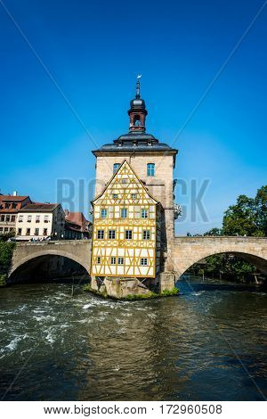 BAMBERG, GERMANY - Circa September, 2016: River Regnitz flowing past the Rathaus, or Old Town Hall, which is built on an island in the center of the river in this UNESCO World Heritage Site