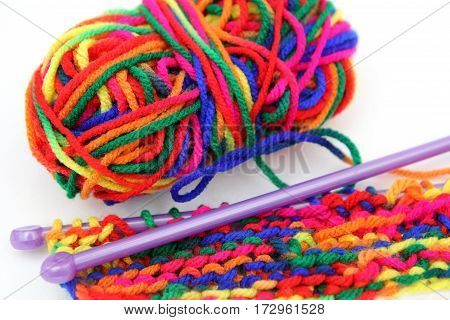 Bright Multi-coloured Colorful Knitting Wool Or Yarn With Knitting Needles On White Background